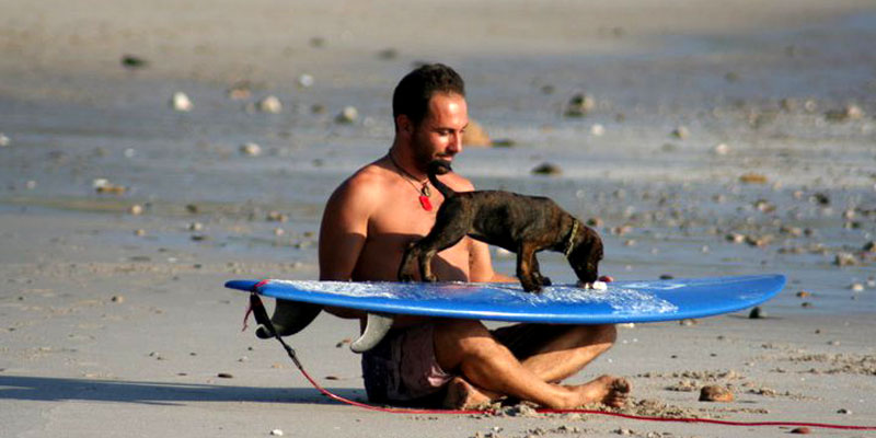 Denis shares his love for surfing with a new friend