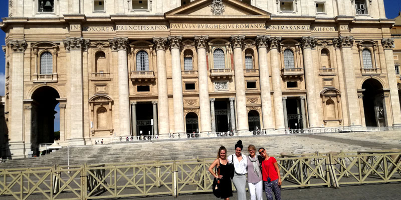 Looking small in front of St. Peter's Basilica